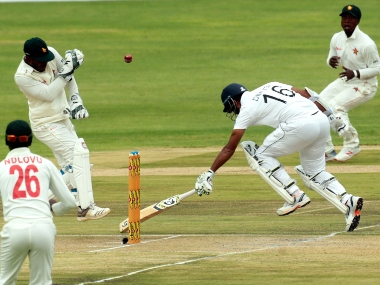 "Sri Lanka batsman Dimuth Karunaratne,right, avoids a run out during the test match against Zimbabwe at Harare Sports Club, Monday, Jan,20, 2020.Zimbabwe is playing in its first international match since the International Cricket Council lifted the country""s ban last year(AP Photo/Tsvangirayi Mukwazhi) ///"