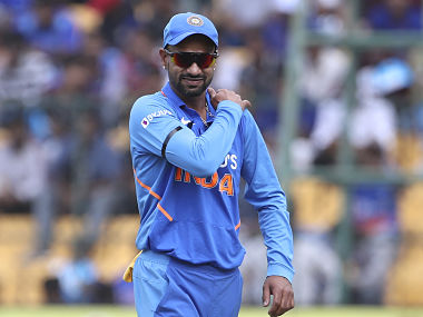 India's Shikhar Dhawan holds his shoulder as he leaves the ground after getting hurt while fielding during the third one-day international cricket match between India and Australia in Bangalore, India, Sunday, Jan. 19, 2020. (AP Photo/Aijaz Rahi)