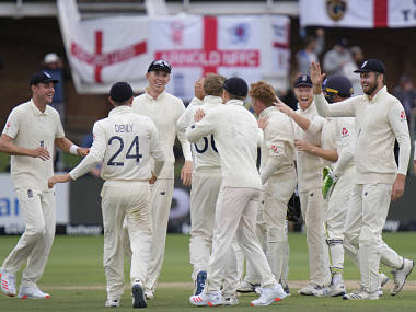 England team celebrate taking the wicket of South Africa's Rassie van der Dussen, caught by England's Ollie Pope, during day four of the third cricket test between South Africa and England in Port Elizabeth, South Africa, Sunday, Jan. 19, 2020. (AP Photo/Michael Sheehan)