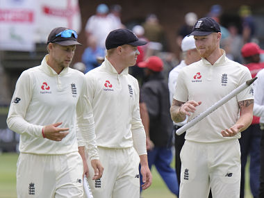 England's captain Joe Root, left, Ollie Pope and Ben Stokes, right, leave the field of play after winning the third cricket test between South Africa and England in Port Elizabeth, South Africa, Monday, Jan. 20, 2020. (AP Photo/Michael Sheehan)