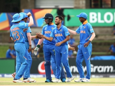 India players celebrate as Ravi Bishnoi (centre) takes a wicket. Image credits @cricketworldcup