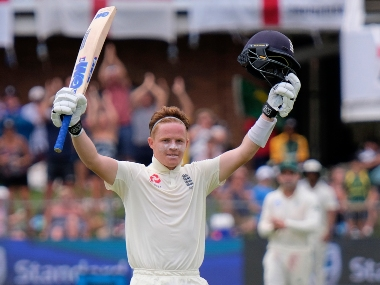 England's Ollie Pope celebrates making his hundred, during day two of the third Test between South Africa and England in Port Elizabeth, South Africa. AP