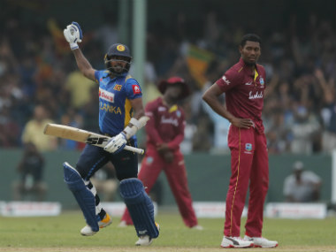 Sri Lanka's Wanidu Hasaranga, left, celebrates scoring the winning run to defeat West Indies by one wicket in the first ODI of the three-match series at Colombo. AP