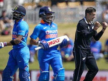 Hamish Bennet, right, celebrates the wicket of Virat Kholi during the 3rd ODI. AP
