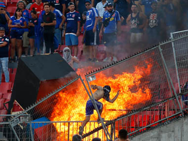 Chilean protestors set fire to seats pelt police with missiles at Copa Libertadores match between Universidad de Chile and Internacional