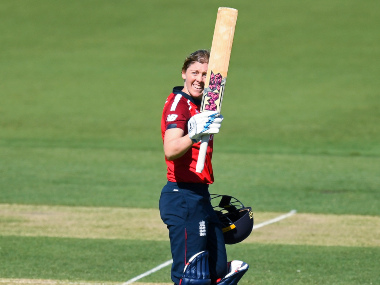 England skipper Heather Knight raises her bat after completing a 63-ball ton. AP