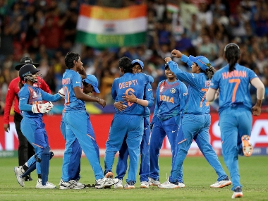 The Indian team celebrate the wicket of Australia's Ashleigh Gardner in the first game of the Women's T20 Cricket World Cup in Sydney. AP