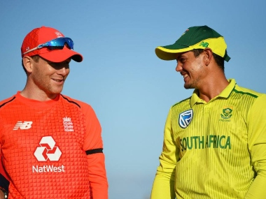 England skipper Eoin Morgan (L) and Quinton de Kock, South Africa's captain, exchange pleasantries at the toss. ICC