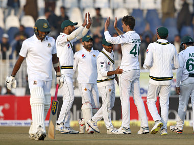 Pakistan pacer Shaheen Shah Afridi, center, celebrates with teammates after taking the wicket of Bangladesh batsman Rubel Hossain, left, during the first day of their 1st test cricket match at Rawalpindi cricket stadium in Rawalpindi, Pakistan, Friday, Feb. 7, 2020. (AP Photo/Anjum Naveed)