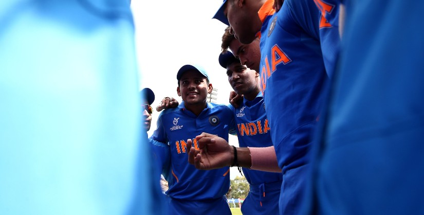 Priyam Garg in conversation with his teammates during a match at U19 World Cup. Photo ICC