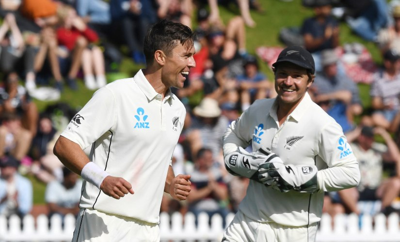 New Zealand's Trent Boult, left, with BJ Watling celebrates bowling India's Cheteshwar Pujara for 11 during the first Test between India and New Zealand at the Basin Reserve in Wellington, New Zealand. AP