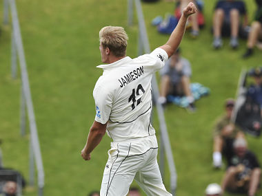 New Zealand's Kyle Jamieson celebrates after taking his first test wicket, dismissing India's Cheteshwar Pujara for 11 during the first cricket test between India and New Zealand at the Basin Reserve in Wellington, New Zealand, Friday, Feb. 21, 2020. (AP Photo/Ross Setford)