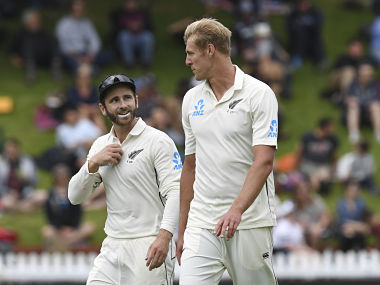 New Zealand bowler Kyle Jamieson, right, talks to captain Kane Williamson during the first cricket test between India and New Zealand at the Basin Reserve in Wellington, New Zealand, Friday, Feb. 21, 2020. (AP Photo/Ross Setford)