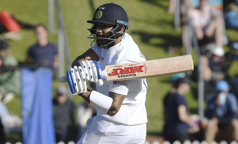 India's Virat Kohli sweeps around to be caught off the bowling of New Zealand's Trent Boult for 19 during the first cricket test between India and New Zealand at the Basin Reserve in Wellington, New Zealand, Sunday, Feb. 23, 2020. (AP Photo/Ross Setford)