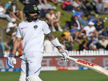 India's Virat Kohli walks, out for 19 to New Zealand's Trent Boult during the first Test between India and New Zealand at the Basin Reserve in Wellington, New Zealand. AP