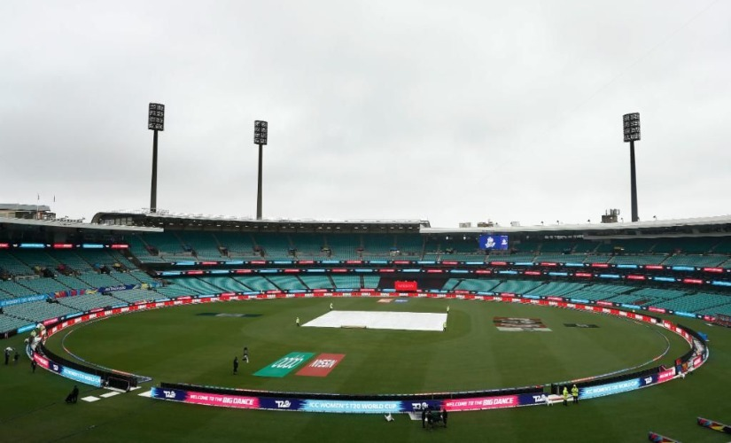 Covers on the pitch of the Sydney Cricket Ground as rain pours. AP
