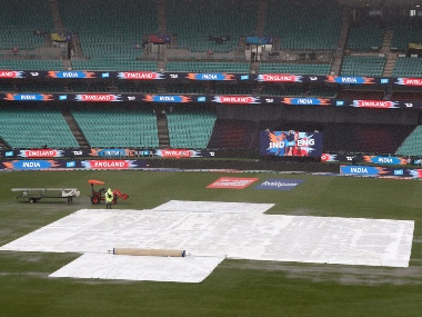 Rain falls on the Sydney Cricket Ground delaying the start of the Women's T20 World Cup cricket semifinal matches in Sydney, Thursday, March 5, 2020. India are scheduled to meet England while hosts Australia and South Africa are to play the second semifinal. (AP Photo/Rick Rycroft)