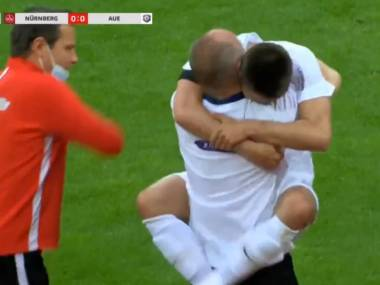 German second division player Dimitrij Nazarov breaks rules to celebrate goal with hug for driver that saved his life