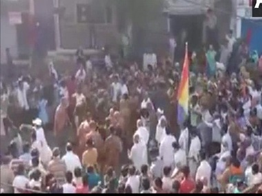 Flouting social distancing guidelines crowd in Madhya Pradeshs Sagar gathers on street to welcome group of Jain monks