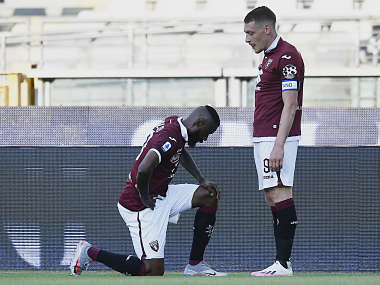 Serie A Torinos Nicolas Nkoulou takes a knee after scoring against Parma as Italian league resumes