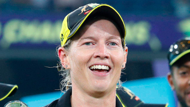 Australia's captain Meg Lanning carries their trophy as the team celebrates their win over India in the Women's T20 World Cup cricket final match in Melbourne, Sunday, March 8, 2020. (AP Photo/Asanka Ratnayake)