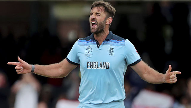 England's Liam Plunkett celebrates the dismissal of New Zealand's Henry Nicholls during the Cricket World Cup final match between England and New Zealand at Lord's cricket ground in London, England, Sunday, July 14, 2019. (AP Photo/Aijaz Rahi)