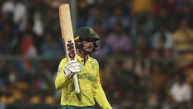 South Africa's captain Quinton de Kock raises his bat to celebrate scoring fifty runs during the third and last T20 cricket match between India and South Africa in Bangalore, India, Sunday, Sept. 22, 2019. (AP Photo/Aijaz Rahi)