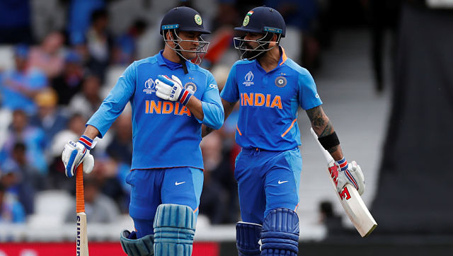 Cricket - ICC Cricket World Cup - India v Australia - The Oval, London, Britain - June 9, 2019 India's MS Dhoni and Virat Kohli Action Images via Reuters/Paul Childs - RC1C9AFF6AB0