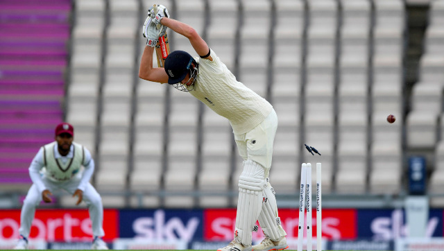 Dom Sibley gets his off-stump rattled while attempting to leave an inswinger bowled by Shannon Gabriel on Day 1. AP