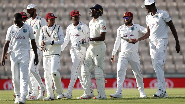England's Jofra Archer departs the field with West Indian players at the end of play on the fourth day. AP