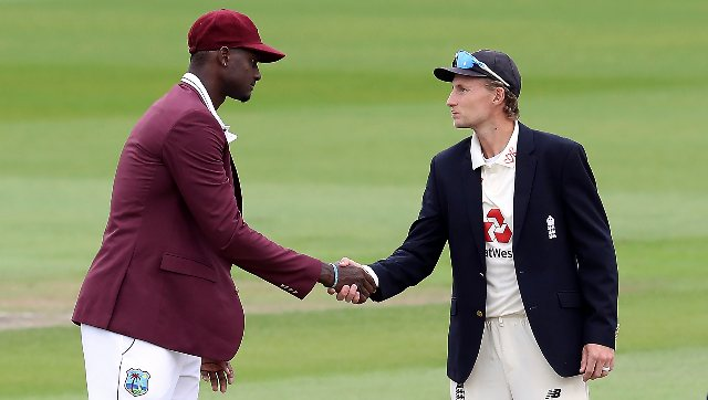 West Indies skipper Jason Holder and his England counterpart Joe Root at the toss on Friday ahead of the third Test. AP