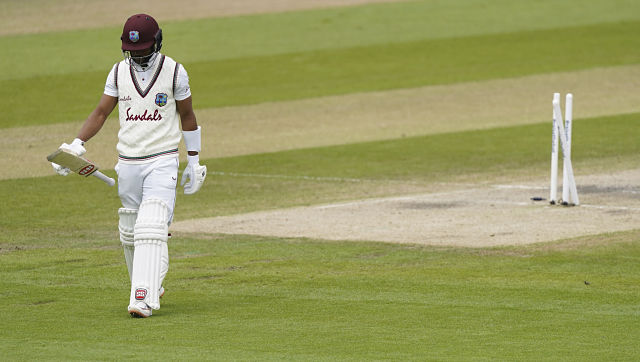 West Indies' Shai Hope walks off the field after being dismissed by England's Stuart Broad during the last day of the second cricket Test match between England and West Indies at Old Trafford in Manchester, England, Monday, July 20, 2020. (AP Photo/Jon Super, Pool)