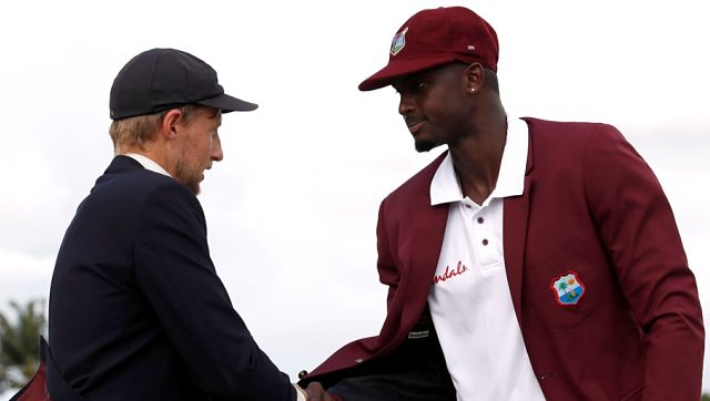 File image of England skipper Joe Root and his West Indian counterpart Jason Holder. Reuters