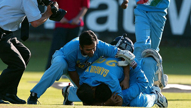 Indian players Yuvraj Singh (L) and Sourav Ganguly jump on winning batsman Zaheer Khan as Tinu Yohannan runs in after India won the Natwest series Final at Lords, July 13, 2002. India beat England's score of 325 with 3 balls remaining. REUTERS/Stephen Hird SH/cmc - RP3DRHZVCQAB