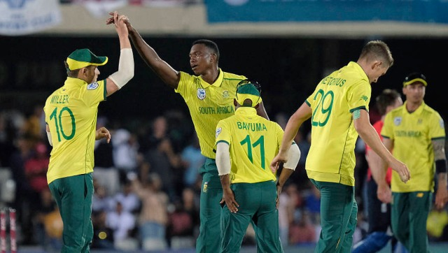 David Miller of South Africa left and Lungi Ngidi of South Africa right celebrate Ben Stokes of England wicket during the T20 cricket match between South Africa and England in East London, South Africa, Wednesday, Feb. 12, 2020. (AP Photo/Michael Sheehan)