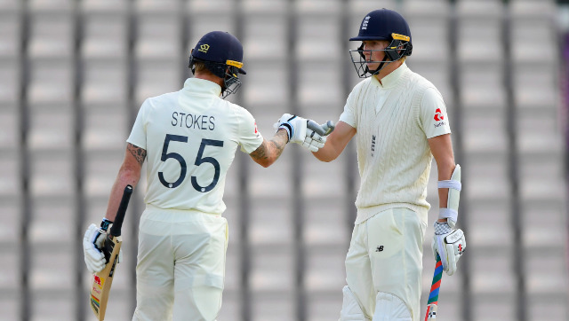 Zak Crawley is congratulated by captain Ben Stokes after reaching his half-century on Day 4. AP