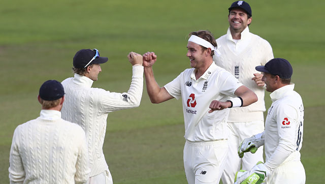 England players celebrate after Stuart Broad dismissed West Indies' John Campbell during the third day of the third Test against West Indies. AP Photo