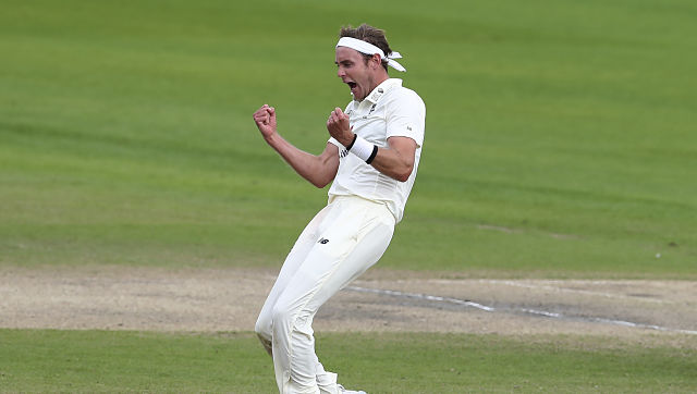 England's Stuart Broad celebrates the dismissal of West Indies' Roston Chase during the second day of the third Test against West Indies at Old Trafford. AP Photo