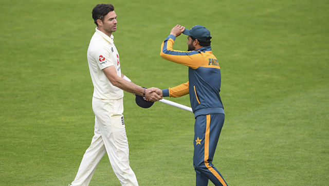 Pakistan's captain Azhar Ali shakes hands with England's James Anderson at the end of the fifth day of the third Test. AP