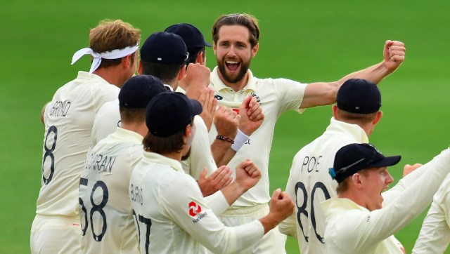 Chris Woakes celebrates with teammates after getting an unsuccessful lbw appeal against Fawad Alam overturned. AP