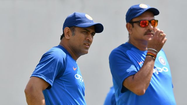 File image of MS Dhoni and Ravi Shastri. AFP