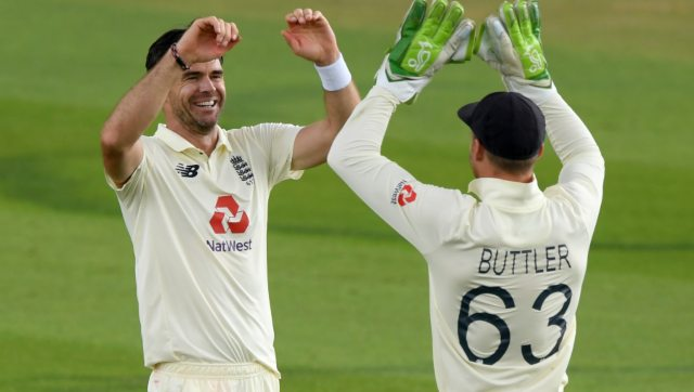 England's James Anderson, left, celebrates with Jos Buttler the dismissal of Pakistan's captain Azhar Ali during first day of second Test. AP