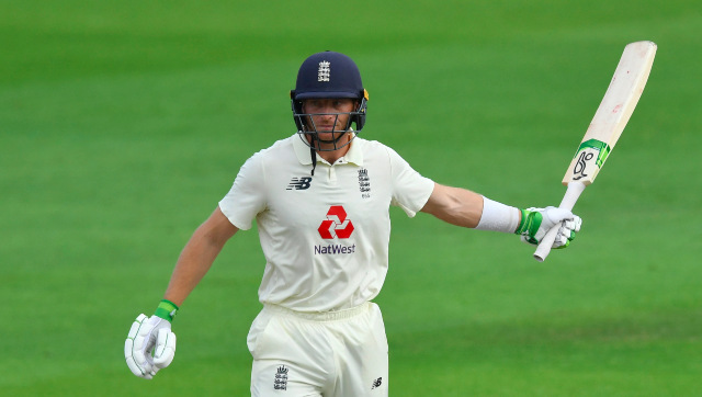 Jos Buttler struck a defiant 75 to forge a match-winning 139-run stand with Chris Woakes and guide England to a three-wicket win. AP
