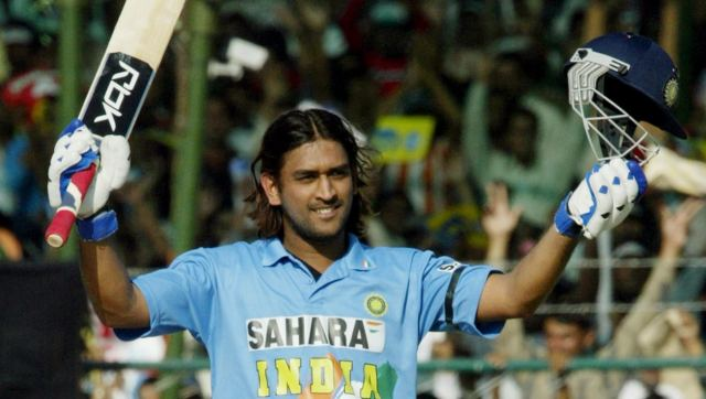 MS Dhoni celebrates after reaching a century against Sri Lanka. AFP