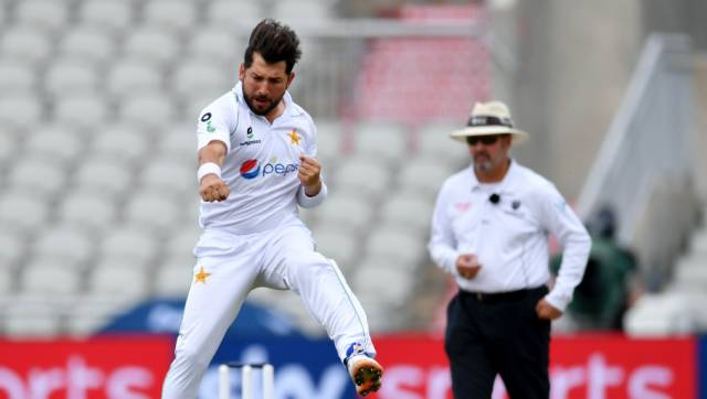 Pakistan's Yasir Shah jumps to celebrate the dismissal of England's Jos Buttler during the third day of the first cricket Test match between England and Pakistan at Old Trafford in Manchester, England, Friday, Aug. 7, 2020. (Dan Mullan/Pool via AP)