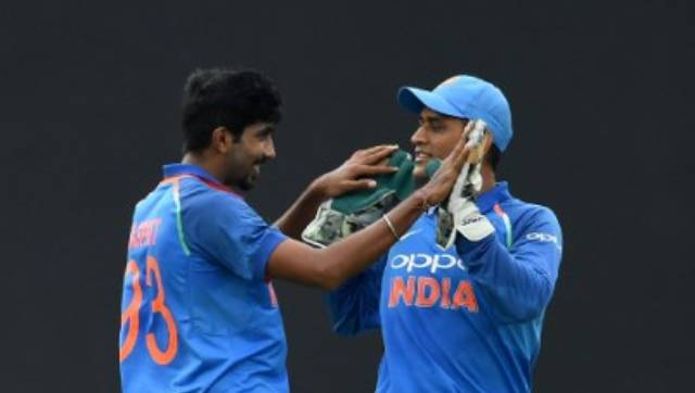 File image of Jasprit Bumrah and MS Dhoni. AFP