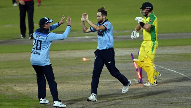 Chris Woakes celebrates bowling out Aaron Finch for 73 runs during second ODI. AP