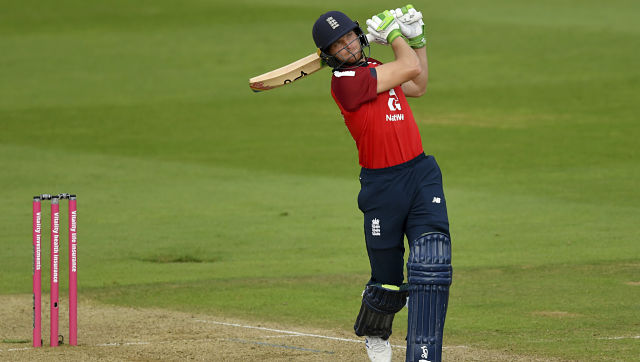 England's Jos Buttler hits a six to win the second Twenty20 cricket match between England and Australia, at the Ageas Bowl in Southampton, England, Sunday, Sept. 6, 2020. (Dan Mullan/Pool via AP)