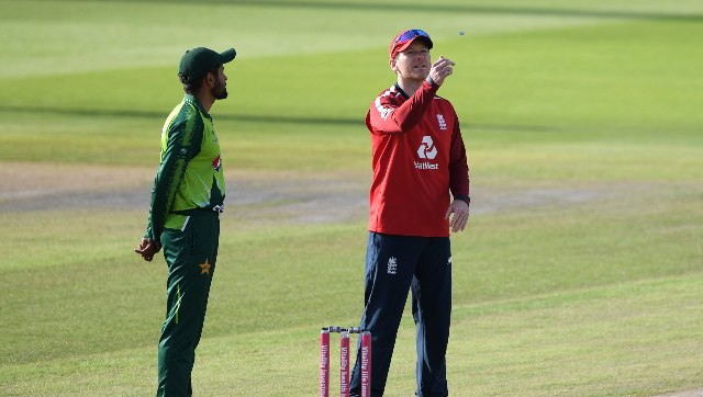 Pakistan skipper Babar Azam (Left) and his Egland counterpart Eoin Morgan during the toss before the third T20I. AP