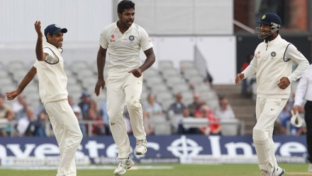 Varun Aaron (C) celebrates taking the wicket of Moeen Ali IN 2014 Manchester Test. AFP